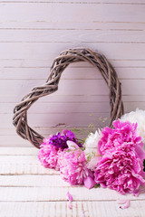 Pink and white peonies flowers  and decorative heart