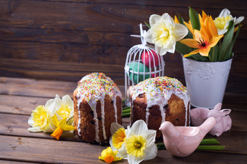 Colorful Easter cakes, flowers and Easter decorations  on  dark