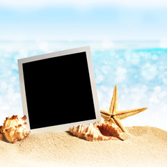 photo frames on the sea sand