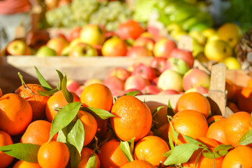 Closeup picture of fresh oranges fruits and vegitables at market