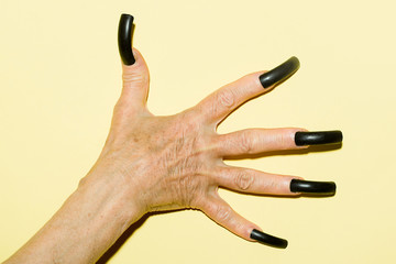 Old female hand with nails
