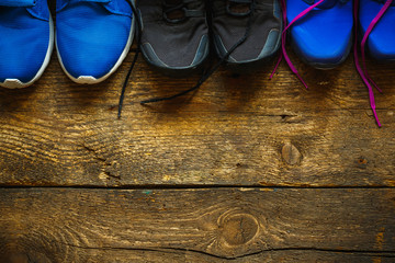 Close up of sneakers on wooden background