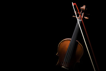Old ,retro violin on the black background.