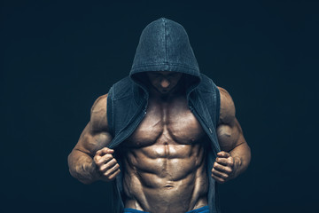 Man with muscular torso. Strong Athletic Men Fitness Model Torso showing six pack abs