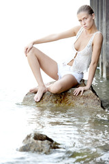 Young Female Model Posing In The Water
