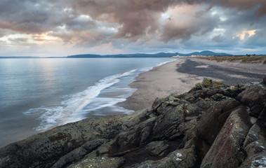 Beautiful Cumulus Clouds over Rocky Coast in Wales