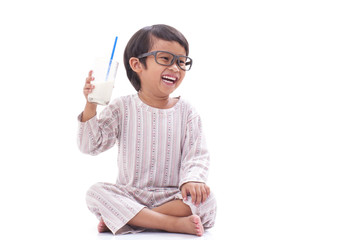 Little boy with a glass of milk