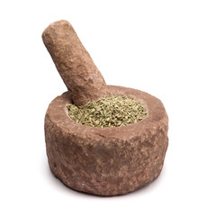 Organic Fennel seed (Foeniculum Vulgare) in mortar with pestle, isolated on white background.