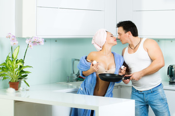 Kissing couple in kitchen