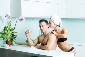 Sexual couple in kitchen