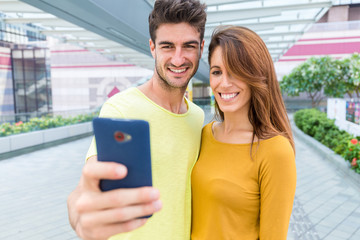 Caucasian couple take the selfie by mobile phone