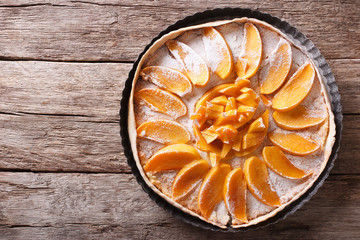 Tart with persimmon and cream cheese. Horizontal top view