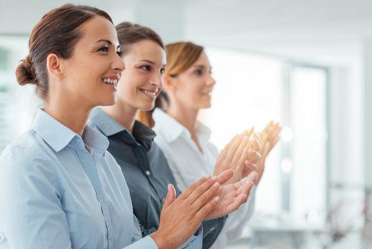 Cheerful business women applauding