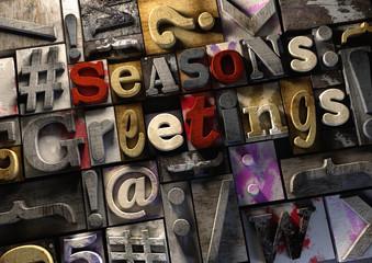 Seasons Greetings title on retro wooden print blocks