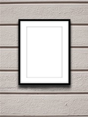 Close-up of one black picture frame on concrete wall background with horizontal lines