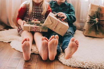 Portrait of happy children with Christmas decorations. Two kids