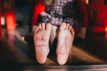baby bare feet on the wooden floor. Christmas celebration concep