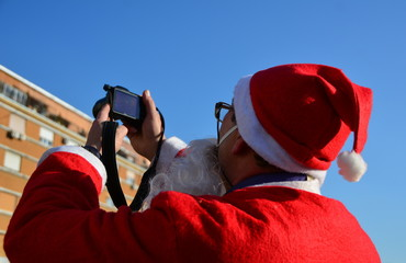 Santa Claus photographer with camera