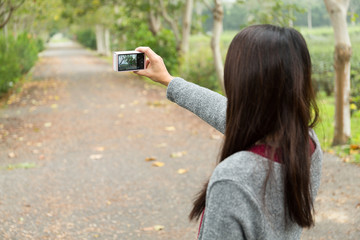 Woman use of the camera for taking photo when go traveling
