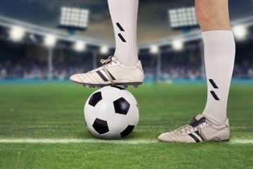 Wall Mural - Fußballspieler im Stadion mit Ball