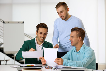 Young business men at the meeting in a conference room
