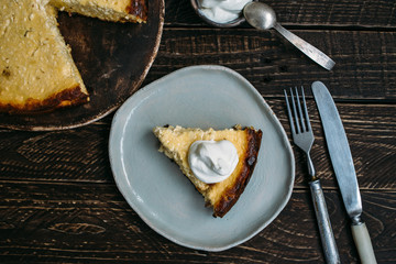 cheesecake with sour cream. healthy Eating, a piece of cheese cake, handmade tableware, cheese breakfast