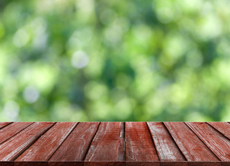 Wood table top on green bokeh and lens flare background