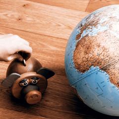 Money box with globe of world