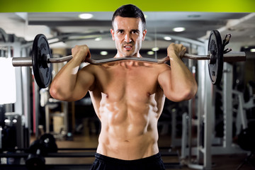 Fit male doing biceps exercise