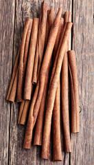 Cinnamon sticks on a wooden background