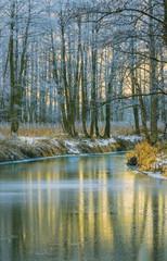 Fototapete - Reflection of sunset on a thin ice. River Sukhodrev. Kaluga regi