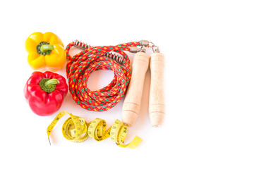 skipping rope and yellow tape measure on a white background