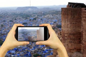 blue city JODHPUR, India. Taking photo on smart phone concept.