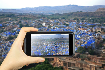 blue city JODHPUR, India. Taking photo on smart phone concept.