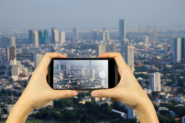 Bangkok skyline cityscape, Thailand. Taking photo on smart phone