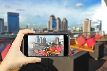luxury hotel, Bangkok. Taking photo on smart phone concept.