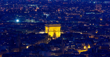 PARIS - 6 AUGUST 2013: Illuminated Eiffel Tower at night and peo