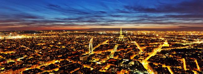 PARIS - 6 AUGUST 2013: Illuminated Eiffel Tower at night and peo