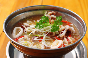 spicy squid soup in metal dish