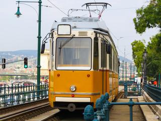 Historic yellow tram on the street, Budapest
