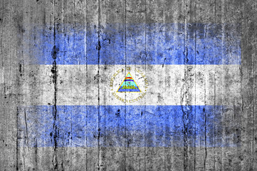 Nicaragua flag painted on background texture gray concrete