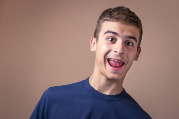 Surprised face of a young man. Great news for a teen boy.