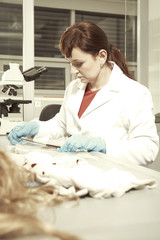 Inside crime laboratory - testing of evidences and collecting of traces by criminologist
