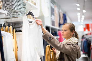Young woman shopping in a fashion store