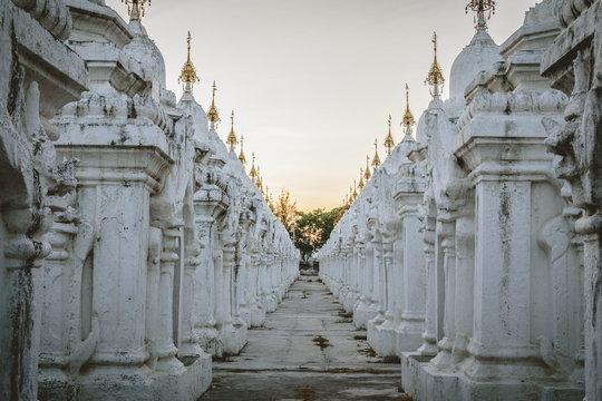 White stupas at Kuthodaw Pagoda at Sunset in Mandalay, Myanmar