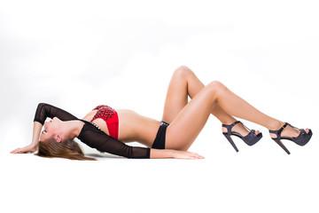 Pretty sporty woman dancer concert wearing costume, dancing and posing in studio