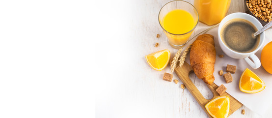 Croissants, coffee and orange juice, top view. Breakfast concept