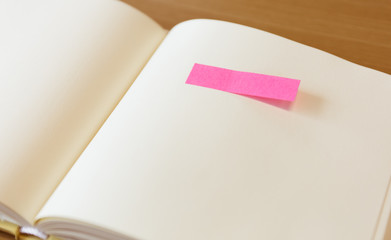 Empty paper with post it paper on page