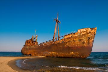 Acrylic Prints Shipwreck Old Ship. Ancient shipwrecks in the sea with sunset background. Dimitrios shipwreck at Selinitsa beach near Gytheio, Greece