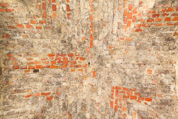 Old wall of broken red brick